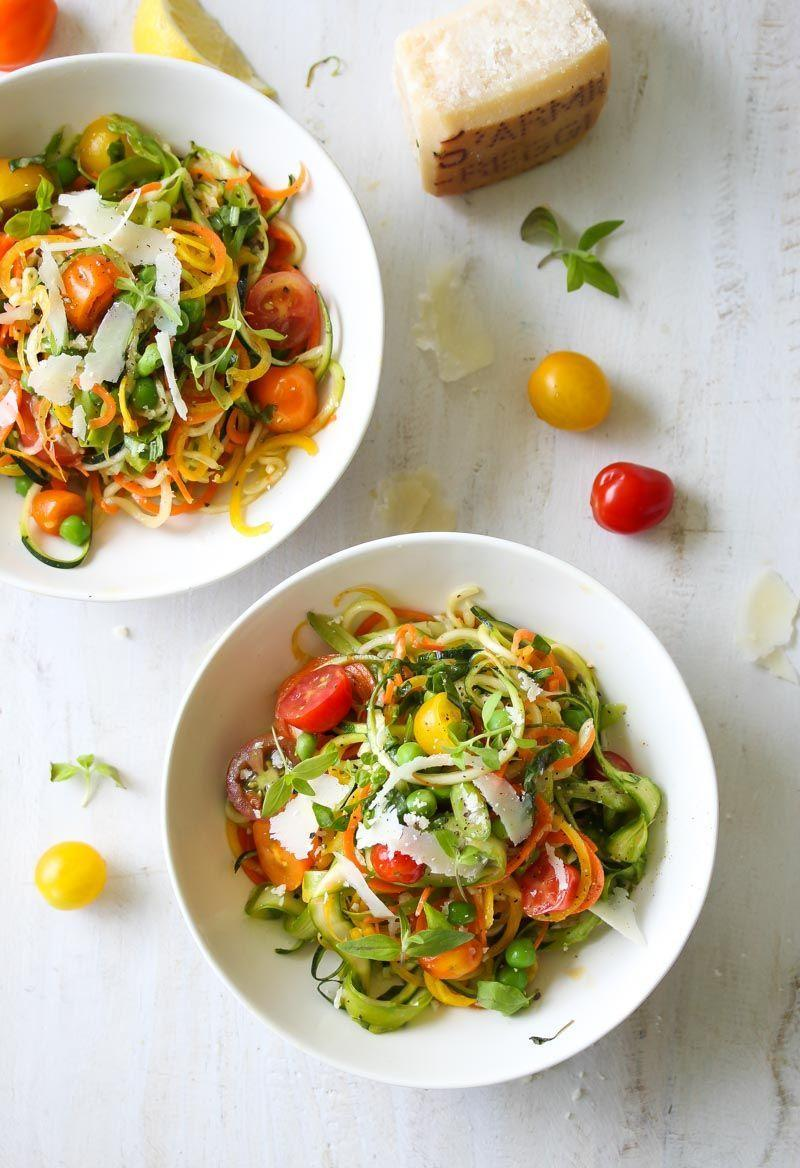 """<p>Shaved parmesan cheese ties everything together in <em>Dishing Out Health</em>'s updated version of this seasonal delight. <strong>Jamie Vespa, MS, RD</strong>, drafted the recipe to be perfected in just 15 minutes.</p><p><a href=""""https://dishingouthealth.com/spring-vegetable-primavera/"""" rel=""""nofollow noopener"""" target=""""_blank"""" data-ylk=""""slk:Get the recipe from Dishing Out Health »"""" class=""""link rapid-noclick-resp""""><em>Get the recipe from Dishing Out Health »</em> </a></p>"""