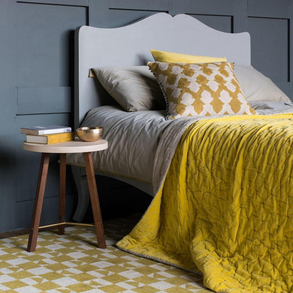 """<p>This year there are two 'It' colours, <a href=""""https://www.housebeautiful.com/uk/decorate/a34908783/pantone-colour-year-illuminating-ultimate-grey/"""" rel=""""nofollow noopener"""" target=""""_blank"""" data-ylk=""""slk:Ultimate Grey and Illuminating"""" class=""""link rapid-noclick-resp"""">Ultimate Grey and Illuminating</a>; a solid grey and vibrant yellow. It's a stunning combination too – the cool neutral of the grey then a hit of bright yellow really makes it sing.<br></p><p>Top Tip: Painting the bed a different grey to the <a href=""""https://www.housebeautiful.com/uk/renovate/diy/a35288060/how-to-panel-wall/"""" rel=""""nofollow noopener"""" target=""""_blank"""" data-ylk=""""slk:wall panelling"""" class=""""link rapid-noclick-resp"""">wall panelling</a> behind makes it stand out but continues the colour theme.</p><p>Pictured: <a href=""""https://www.frenchbedroomcompany.co.uk/chartreuse-yellow-velvet-throw"""" rel=""""nofollow noopener"""" target=""""_blank"""" data-ylk=""""slk:Chartreuse yellow velvet quilted bedspread, The French Bedroom Company"""" class=""""link rapid-noclick-resp"""">Chartreuse yellow velvet quilted bedspread, The French Bedroom Company</a></p>"""
