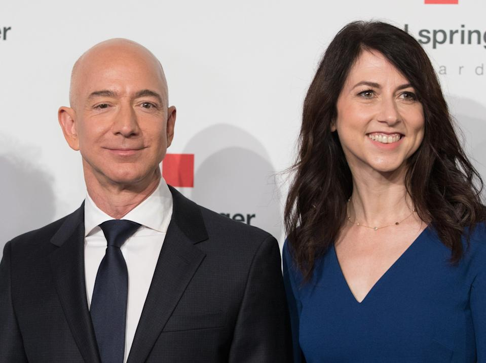 <p>Amazon CEO Jeff Bezos and his wife MacKenzie Bezos poses as they arrive at the headquarters of publisher Axel-Springer where he will receive the Axel Springer Award 2018 on April 24, 2018 in Berlin.</p> (Photo by JORG CARSTENSEN/dpa/AFP via Getty Images))
