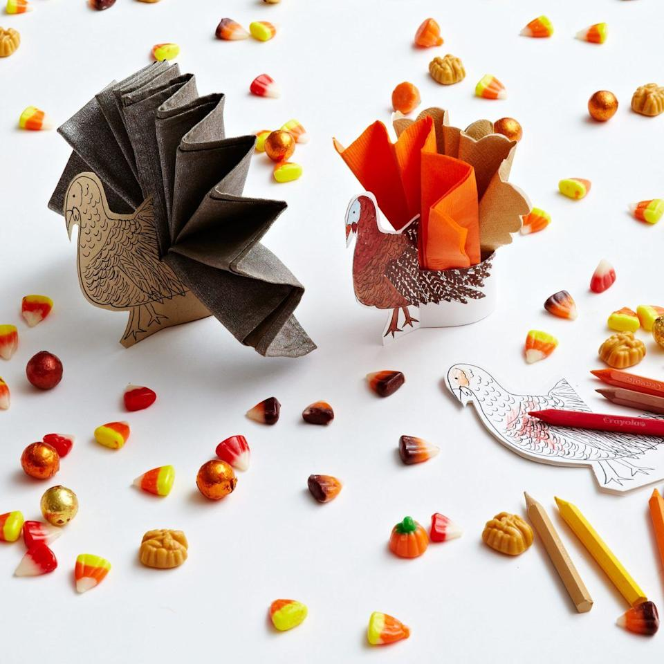 """<p>Here's an activity that can double as a pretty place card <em>and</em> a napkin ring all in one.<em></em> Cut out the turkey, arrange the napkin within it as pictured, then set out a few crayons and let the fun begin!</p><p><strong>Get the tutorial at <a href=""""http://www.darcymillerdesigns.com/ideas/turkey-tail-napkin-rings/"""" target=""""_blank"""">Darcy Miller Designs</a>. </strong></p><p><strong><a class=""""body-btn-link"""" href=""""https://www.amazon.com/Crayola-Bulk-Crayons-52-3008-12-Pack/dp/B002OF2C50?tag=syn-yahoo-20&ascsubtag=%5Bartid%7C10050.g.1201%5Bsrc%7Cyahoo-us"""" target=""""_blank"""">SHOP CRAYONS</a><br></strong></p>"""