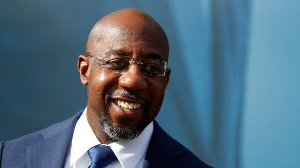 A photograph of Raphael Warnock smiling