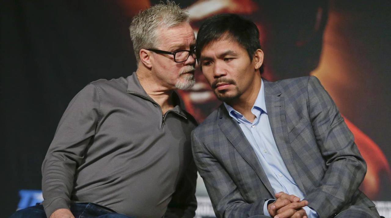 """<p>LOS ANGELES – On July 2, inside a locker room at Suncorp Stadium in Brisbane, Australia, the boxing trainer Freddie Roach found his protégé in the bathroom. Manny Pacquiao stood there, at a mirror, running a comb through his black hair, trying to cover a cut that opened on his head earlier that afternoon. His face was blank but barely marked.</p><p>Roach cared less that Pacquiao had """"lost"""" to Jeff Horn, an unknown Australian welterweight that afternoon. He thought that Pacquiao had won easily and most of the world agreed with him. He cared more, far more, about how Pacquiao looked against Horn, how Pacquiao almost finished Horn in the ninth round but could not summon the kind of late flurry that defined his rise to international superstardom.</p><p>By then, it was obvious. This was Manny Pacquaio. But this wasn't <em>Manny Pacquiao</em>, a boxer who once broke the orbital bones in opponents' faces and struck with the force of a man twice his size, a fighter who made other fighters feel the name of his entrance music. <em>Thunderstruck</em>. """"Manny wasn't himself,"""" Roach told SI.com. """"He didn't look like the Manny Pacquiao I've known for a long time.""""</p><p>Is that the first time you felt that way? Roach is asked. """"The first time ever,"""" he says. """"It was almost over in the ninth. One more round like that and, man …"""" His voice trails off.</p><p>""""He just couldn't do it,"""" Roach says.</p><p>Roach considered all that in the locker room and pushed through Pacquiao's sizeable entourage into the bathroom. He didn't want to come right out and say it— <em>Are you going to retire? Maybe you should think about it—</em> but he wanted to gauge the fighter's reaction to <em>how</em> he fought, not the terrible decision. He wanted to see Pacquiao's body language, hear his thought process. """"I was trying to see where his head was at,"""" Roach says. """"And I could not even get him to say hi to me. I don't know if he was upset with me or what.""""</p><p>It was an unusual bout, to say the lea"""