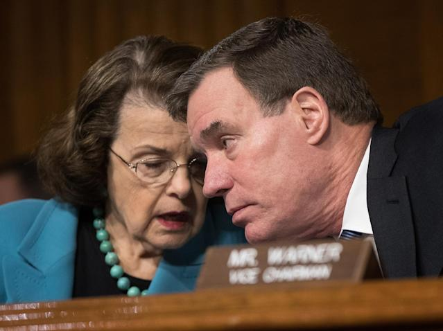 Sen. Dianne Feinstein, D-Calif., confers with Sen. Mark Warner, D-Va., during a Senate Intelligence Committee hearing in March 30. (Photo: Win McNamee/Getty Images)