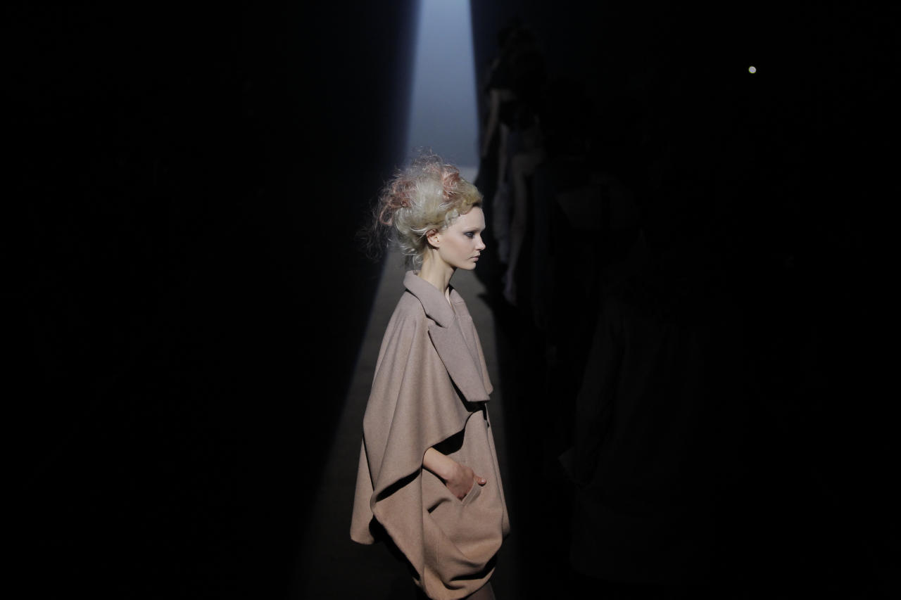 A model displays a creation from A DEGREE FAHRENHEIT designer Yu Amatsu's autumn/winter collection during Fashion Week in Tokyo, Tuesday, March 20, 2012.(AP Photo/Itsuo Inouye)