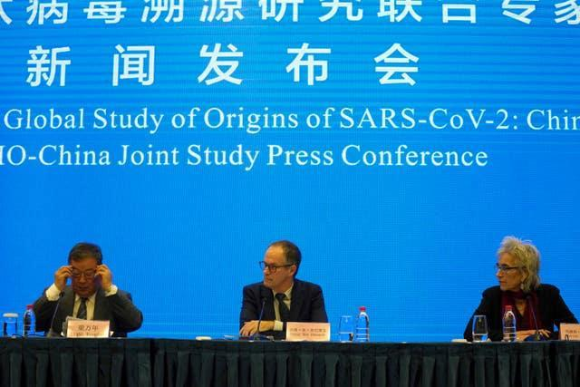 Marion Koopmans, right, and Peter Ben Embarek, centre, of a World Health Organisation team, look over at their Chinese counterpart Liang Wannian, left, during a WHO-China Joint Study press conference in Wuhan in central China's Hubei province