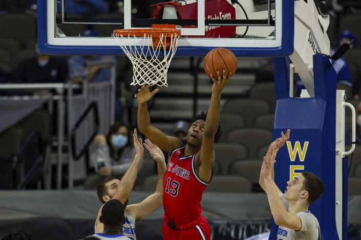 St. John's forward Isaih Moore (13) makes a lay up against Creighton in the first half of an NCAA college basketball game, Saturday, Jan. 9, 2021, in Omaha, Neb. (AP Photo/John Peterson)