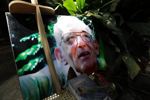 A picture taken on May 12, 2014 shows a portrait of late Dutch Roman Catholic priest, Father Frans van der Lugt displayed on his grave at the monastery of the Jesuit Fathers where he lived in the Old City of Homs