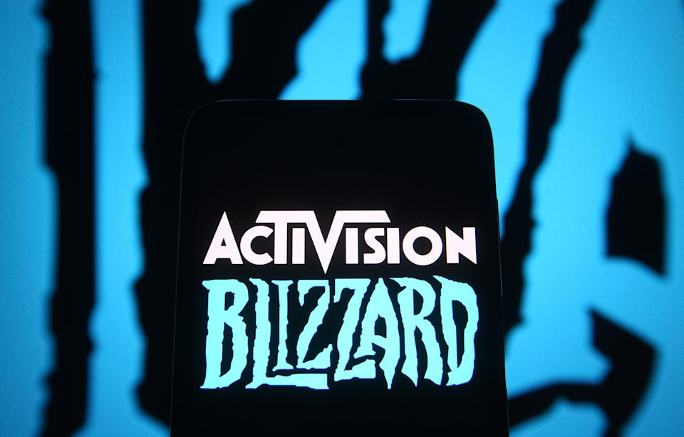 UKRAINE - 2021/06/18: In this photo illustration, Activision Blizzard logo of a video game company is seen on a smartphone screen in front of Blizzard Entertainment logo. (Photo Illustration by Pavlo Gonchar/SOPA Images/LightRocket via Getty Images)