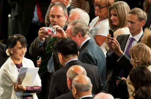 Guests greet Myanmar democracy icon Aung San Suu Kyi (L) after she delivered an address to both houses of parliament in Westminster Hall. The speech was the climax of Suu Kyi's visit to Britain, where she studied and lived for several years until she answered the call of duty in Myanmar, leaving her children and her English husband behind