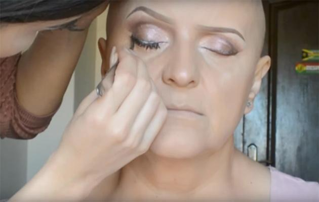 She adds lashes for dramatic effect. Photo: YouTube.