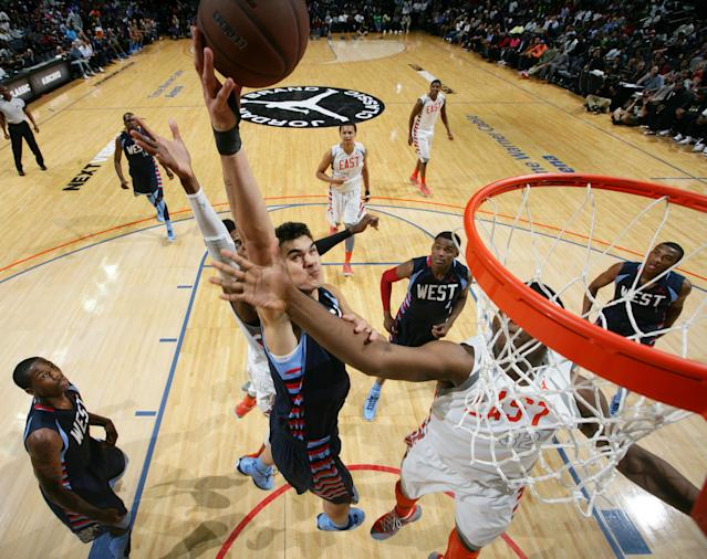 CHARLOTTE, NORTH CAROLINA - APRIL 14: Steven Adams #24 of the West Team shoots against Tony Parker #32 of the East Team during the 2012 Jordan Brand All-American Classic at the Time Warner Cable Arena on April 14, 2012 in Charlotte, North Carolina. (Photo by Ned Dishman/Getty Images)