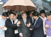 FILE PHOTO: Lee Kun-hee, former Samsung Group chairman, leaves after his trial at a Seoul court