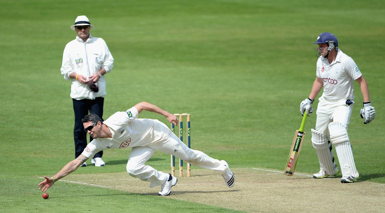 LEEDS, ENGLAND - JUNE 21:  Kevin Pietersen of Surrey fields for his own bowling during day one of the LV County Championship Division One match between Yorkshire and Surrey at Headingley on June 21, 2013 in Leeds, England.  (Photo by Gareth Copley/Getty Images)