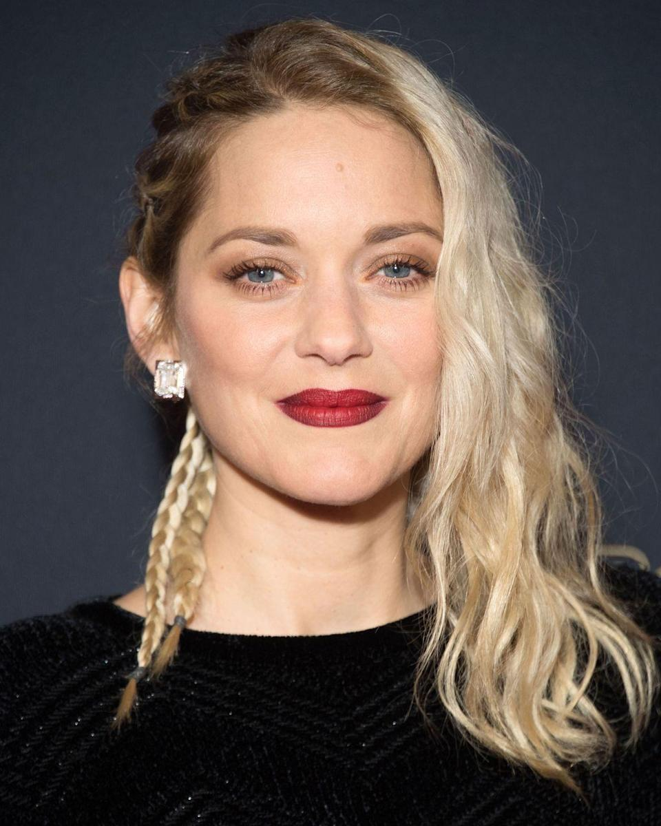 <p>A hairstyle of two halves, we're feeling Marion Cotillard's braids on one side, beachy bleach blonde on the other.</p>