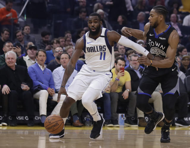 Dallas Mavericks' Tim Hardaway Jr., left, drives the ball against Golden State Warriors' Glenn Robinson III during the first half of an NBA basketball game Tuesday, Jan. 14, 2020, in San Francisco. (AP Photo/Ben Margot)