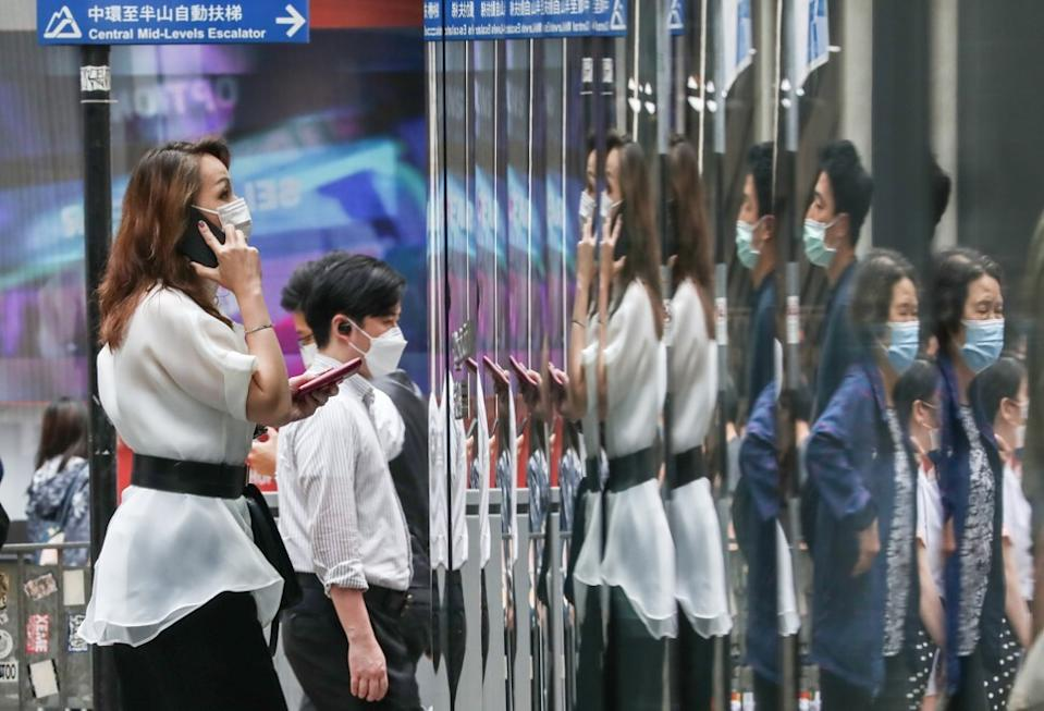Under the poll of Hong Kong firms, the average pay rise for staff was 1.4 per cent this year. Photo: Jonathan Wong