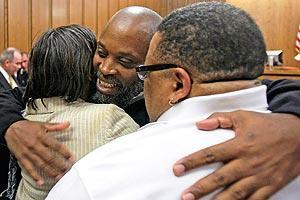 Raymond Towler hugs family members after he is released from prison. The Innocence Project believes Towler is one of the longest-held wrongfully imprisoned people in U.S. history