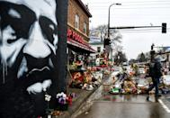 A mural and memorial to George Floyd on the Minneapolis street where he died