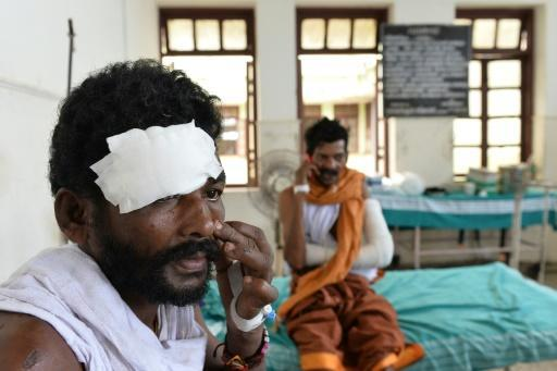 Police take 13 into custody over India temple disaster