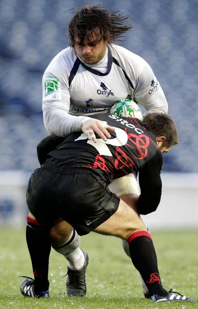 Rodrigo Capo Ortega of French rugby club Castres (l), is tackled by John Houston of Scottish team Edinburgh during a Heineken Cup, pool one, rugby union match at Murrayfield, Edinburgh, Scotland, on December 20, 2010. The game went ahead Monday, after being having been postponed due to bad weather on Sunday. AFP PHOTO/GRAHAM STUART (Photo credit should read GRAHAM STUART/AFP/Getty Images)