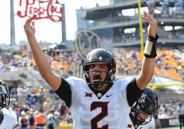 Oklahoma State QB Mason Rudolph celebrates after a touchdown during the first quarter against the Pittsburgh Panthers. (Photo by Joe Sargent/Getty Images)
