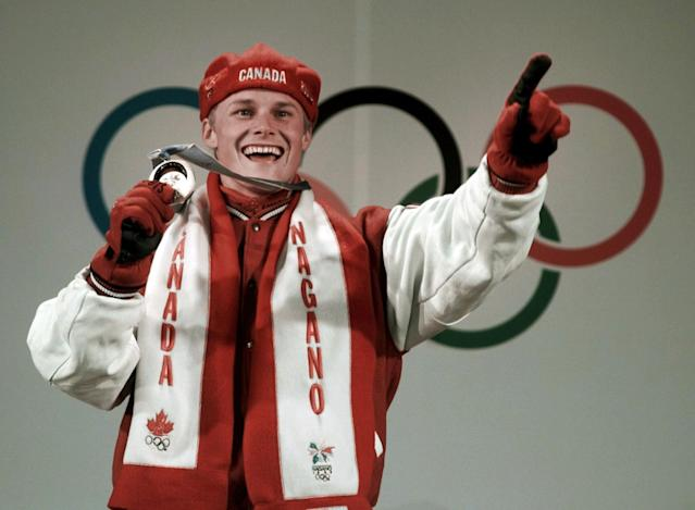 Ross Rebagliati holds his gold medal in the Snowboard Men's Giant Slalom at the victory ceremony for the Winter Olympics in Nagano, Japan, Sunday, Feb. 8, 1998. (AP Photo/Alexander Zemlianichenko)
