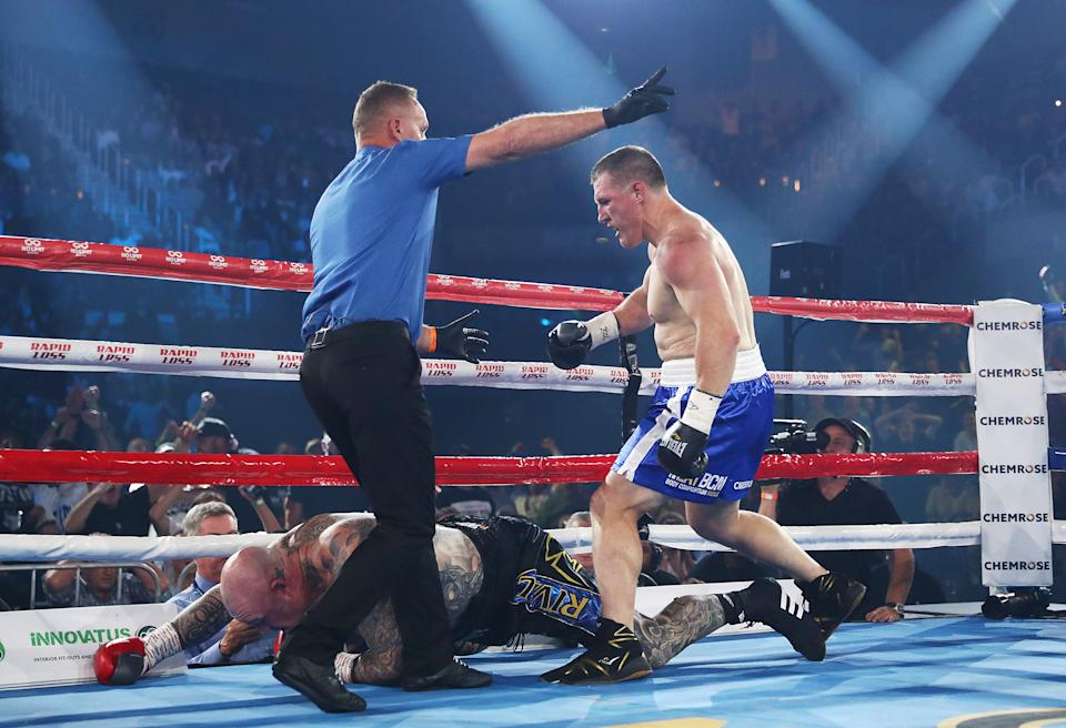 Paul Gallen knocks down Lucas Browne and wins by TKO during their bout at WIN Entertainment Centre.