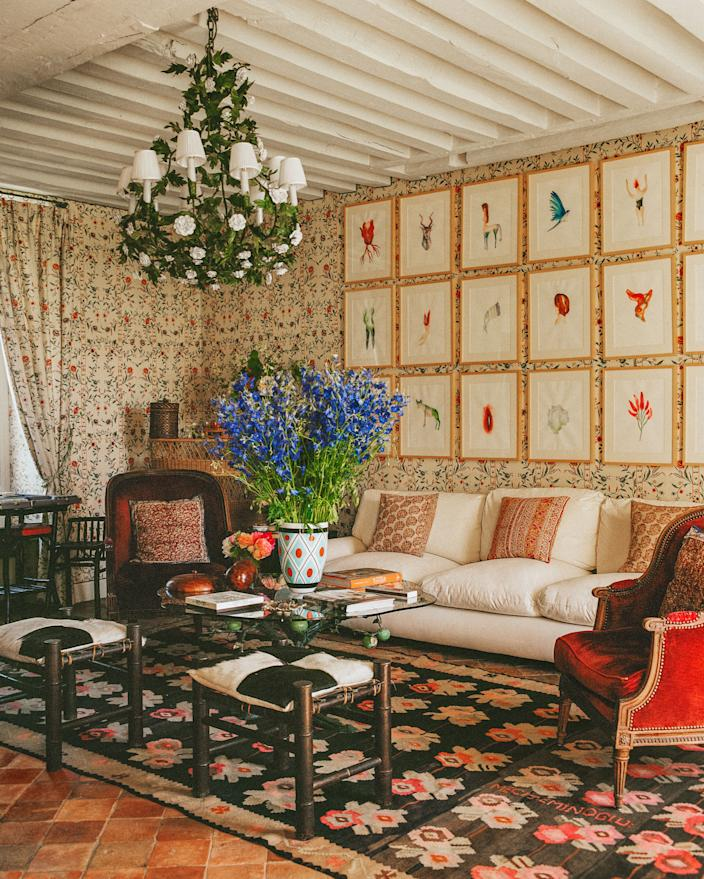 "<div class=""caption""> In the main salon, a blend of vintage furnishings, including a vibrant rug from the Paris flea market, mix with a Bespoke sofa. Moroccan Stools. </div> <cite class=""credit"">Matthieu Salvaing</cite>"