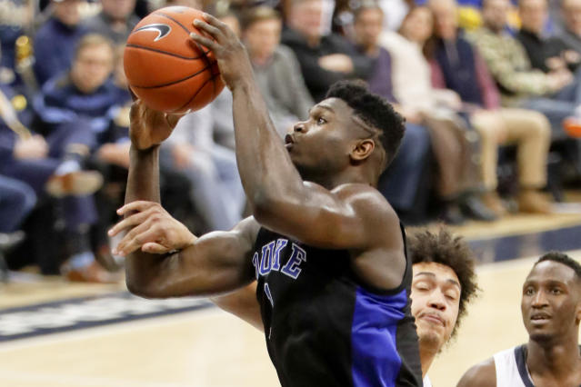Duke's Zion Williamson, left, is fouled by Pittsburgh's Kene Chukwuka as he shoots during the second half of an NCAA college basketball game, Tuesday, Jan. 22, 2019, in Pittsburgh. (AP Photo/Keith Srakocic)