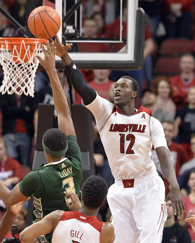 Louisville's Mangok Mathiang, right, attempts to block the shot of South Florida's Zach LeDay during the second half of an NCAA college basketball game, Tuesday, Feb. 18, 2014, in Louisville, Ky. Louisville defeated So. Florida 80-54. (AP Photo/Timothy D. Easley)