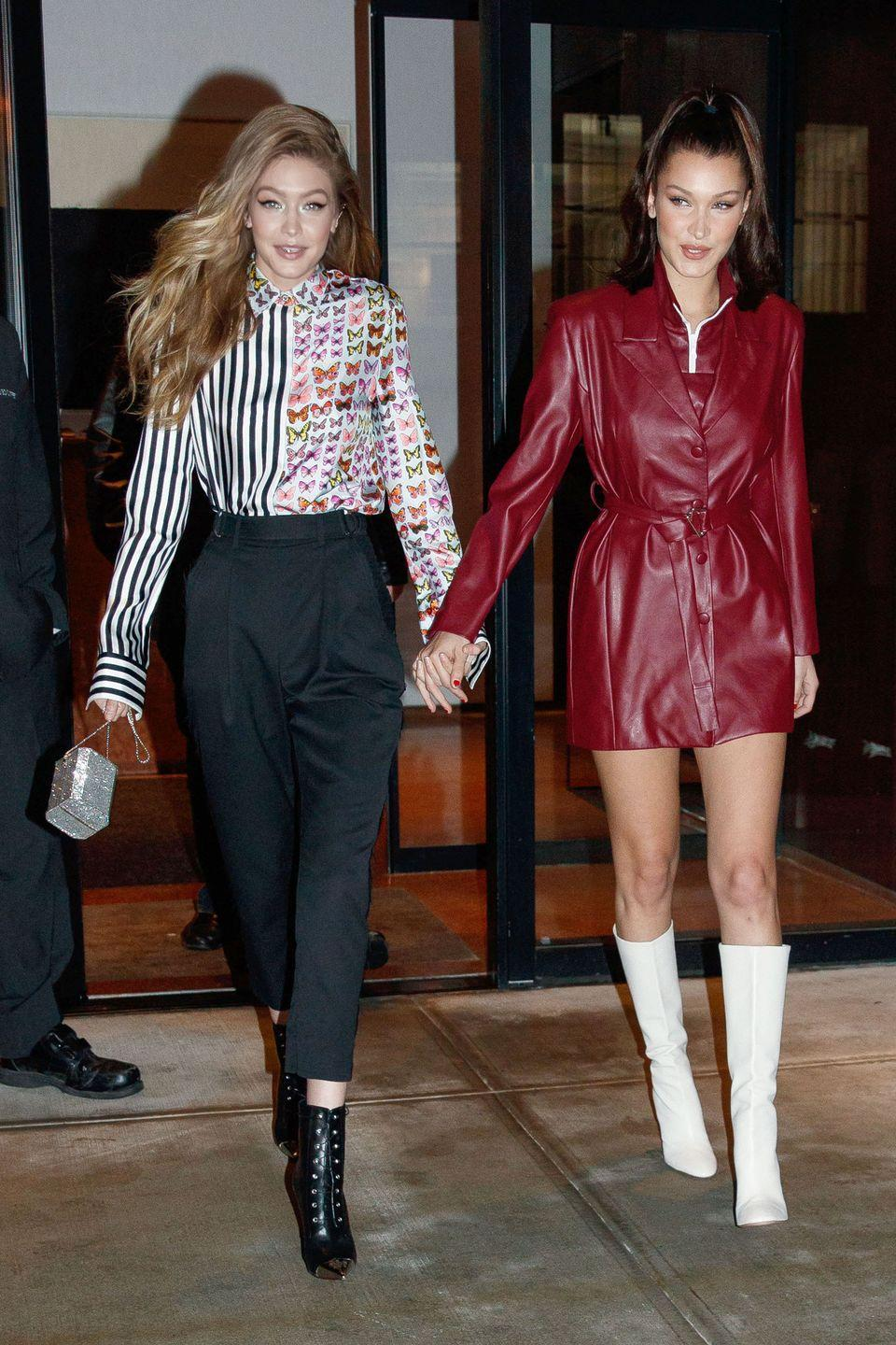 <p>In a red leather coatdress and white boots while out with Gigi Hadid in a printed shirt, high-waisted pants, black ankle boots, and Amanda Pearl mini bag, while out in NYC.</p>
