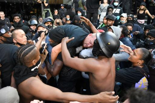 Black Lives Matter demonstrators clashed with rival groups in London