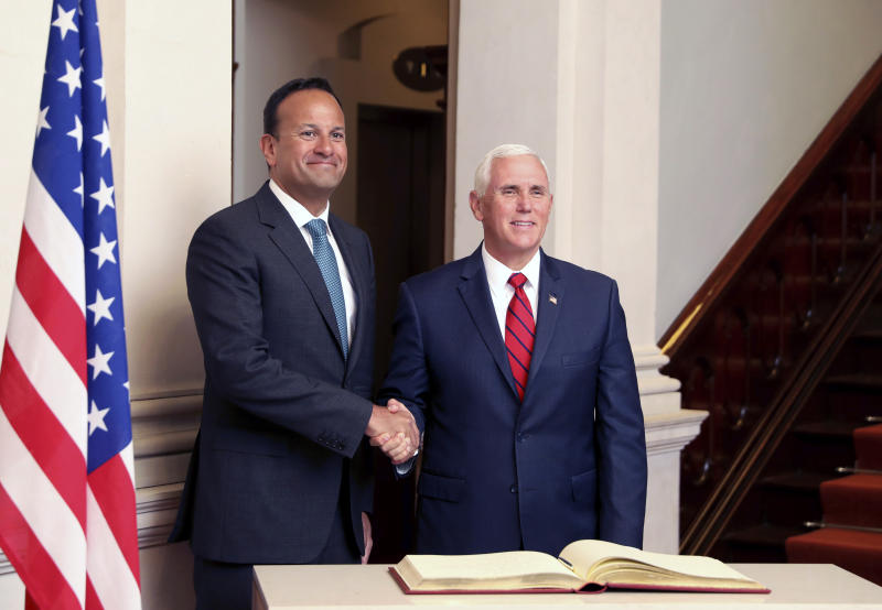 US Vice President Mike Pence is greeted by Irish Prime Minister Leo Varadkar during a visit to Farmleigh House, Dublin, Ireland, Tuesday, Sept. 3, 2019. The Vice President is currently in Ireland for a two day visit. (AP Photo/Peter Morrison)
