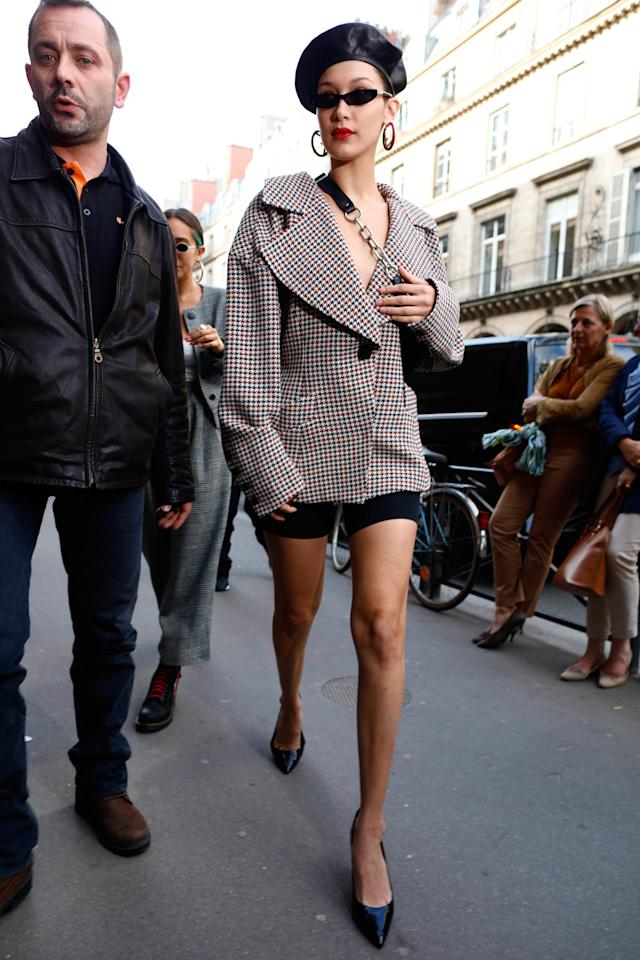 <p><strong>27 September</strong> Bella Hadid channelled French style as she made her way around Paris in a leather Dior beret, cycling shorts and a Claudia Li checked jacket.</p>