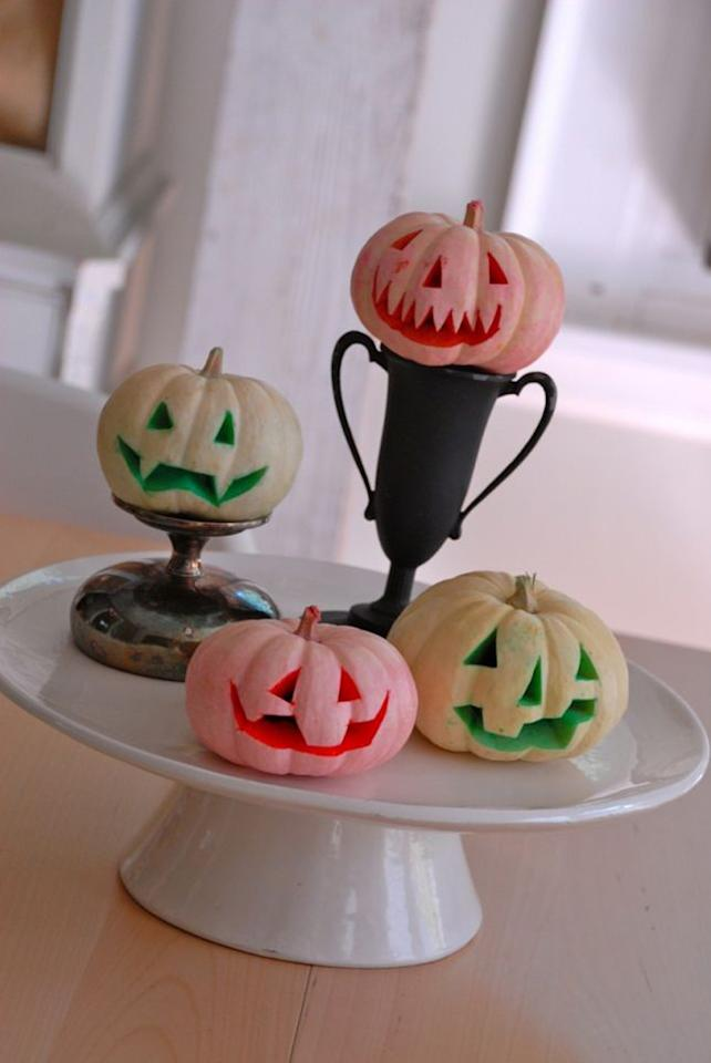 """<p>Mini pumpkins dyed with food coloring are adorable when arranged on a cake plate. <a href=""""http://cfabbridesigns.com/holidays/halloween/dyed-pumpkins/#.VcTdm51VhBf"""" target=""""_blank""""><span></span></a>Get the tutorial at <a href=""""http://cfabbridesigns.com/holidays/halloween/dyed-pumpkins/#.VcTdm51VhBf"""" target=""""_blank"""">Family Chic</a>.</p><p><a href=""""http://cfabbridesigns.com/holidays/halloween/dyed-pumpkins/#.VcTdm51VhBf"""" target=""""_blank""""></a></p>"""