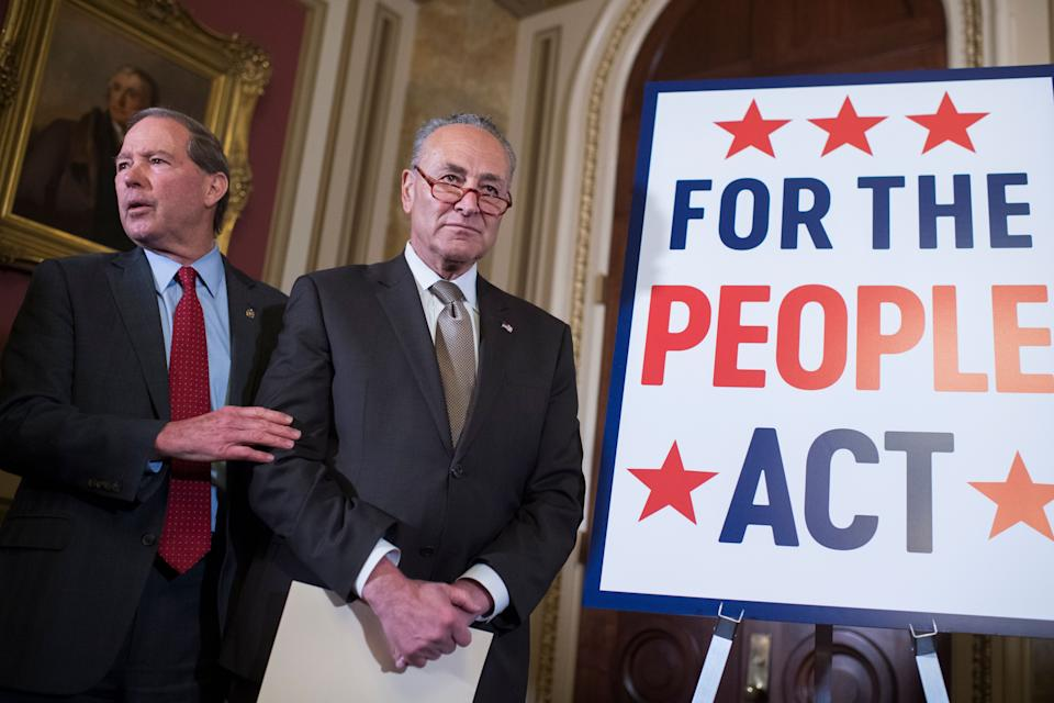 Then-Senate Minority Leader Charles Schumer (center) and then-Sen. Tom Udall (D-N.M.) attend a news conference about the For the People Act on March 27, 2019, in the U.S. Capitol. (Photo: Tom Williams/CQ Roll Call/Getty Images)