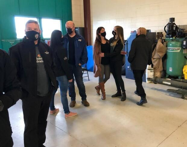 Members of a second contingent of N.L. health-care workers bound for Ontario gathered Tuesday at a military hangar in St. John's.  (Peter Cowan/CBC - image credit)