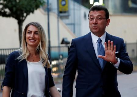 FILE PHOTO: Main opposition Republican People's Party (CHP) mayoral candidate Ekrem Imamoglu, accompanied by his wife Dilek Imamoglu, arrives for an event in Istanbul