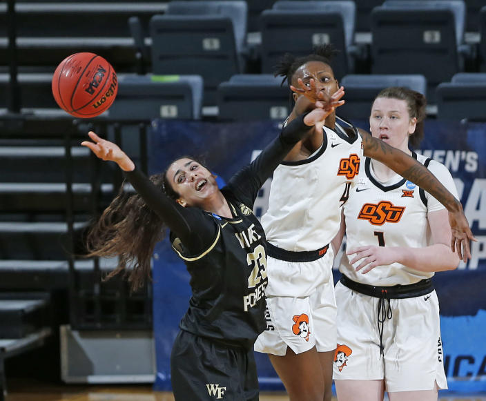 Wake Forest forward Christina Mora and Oklahoma State forward Natasha Mack(4) battle for a rebound during the first half of a college basketball game in the first round of the women's NCAA tournament at the Greehey Arena in San Antonio, Texas, Sunday, March 21, 2021. (AP Photo/Ronald Cortes)