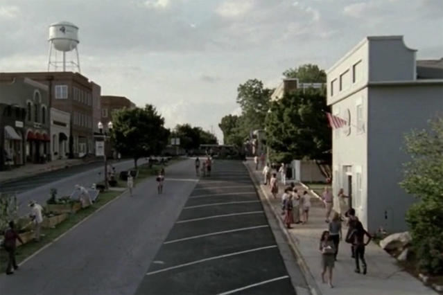 <p>Don't drive to Woodbury, Georgia if you want to see where the Governor ruled. Filming actually took place in the heart of Senoia, Georgia (and the outskirts of the town are used in quite a few other locations).<br>Address: 9 Main St, Senoia, GA 30276<br>(Photo: AMC) </p>