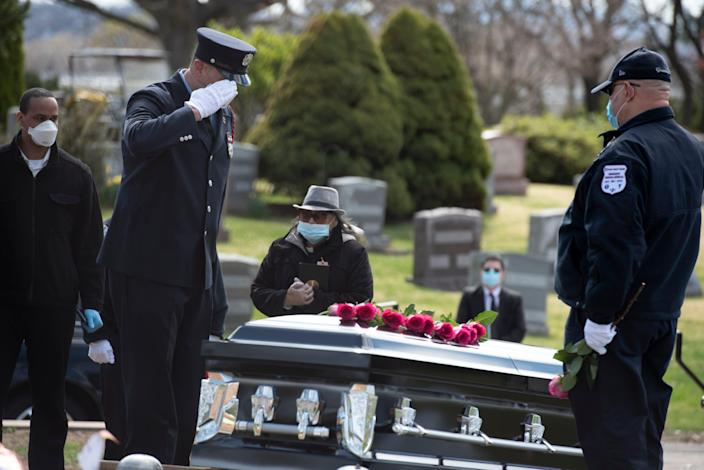 Passaic firefighter Israel Tolentino, 33 who passed away from complications of COVID-19, was laid to rest at East RidgeLawn Cemetery on Thursday, April 2, 2020. Passaic firefighter Rubio Alfaro salutes the casket of his best friend Israel Tolentino.
