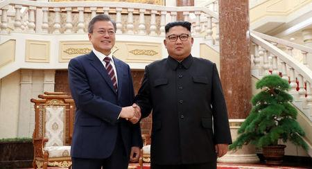 South Korean President Moon Jae-in shakes hands with North Korean leader Kim Jong Un as they arrive for their meeting at the headquarters of the Central Committee of the Workers' Party of Korea in Pyongyang, North Korea, September 18, 2018. Pyeongyang Press Corps/Pool via REUTERS