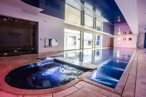 <p>There's a big screen television viewable from the spa, so you can binge-watch your favorite show while you soak.</p>