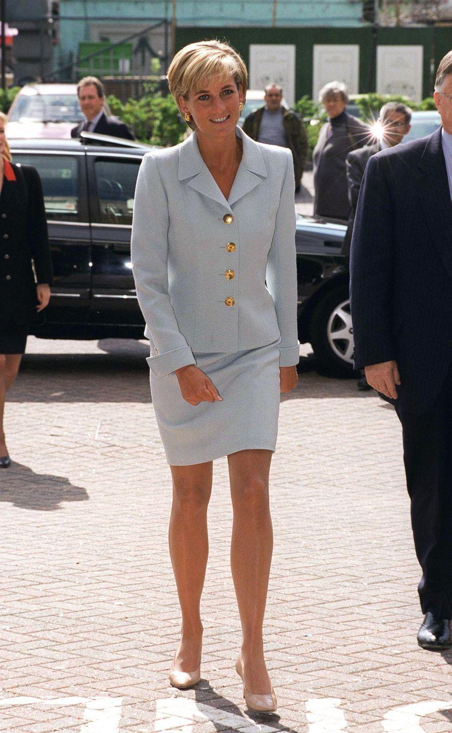 <p>This powder blue suit is tailored to perfection, and was designed by her close friend Gianni Versace. </p>