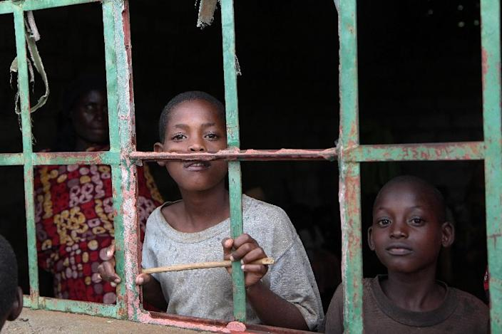 Burundian refugees pictured in a dilapidated building at the Gasora reception centre in Bugesera, Rwanda on April 10, 2015 (AFP Photo/Stephanie Aglietti)