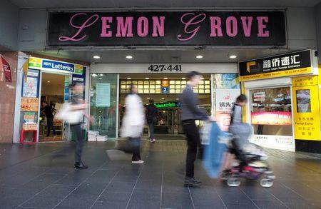 Shoppers walk past the entrance to the Lemon Grove shopping mall in Sydney