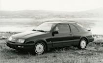 """<p>Based on the hopped-up XR4i version of the European Ford Sierra hatchback, the XR4Ti seemed to have all the right bits: rear-wheel drive, a fully independent suspension, a 2.3-liter turbocharged four, and a five-speed manual transmission. In addition to its mechanical attributes, it made a polarizing visual statement, wearing its biplane rear spoiler and two-tone finish like the rorty rally cars of <a href=""""http://www.caranddriver.com/flipbook/the-story-of-rs-a-visual-history-of-every-ford-rs-model"""" rel=""""nofollow noopener"""" target=""""_blank"""" data-ylk=""""slk:Ford's European RS division"""" class=""""link rapid-noclick-resp"""">Ford's European RS division</a>. <em>C/D</em> came away impressed, declaring that after completing """"several thousand miles in a half-dozen Merkurs, including three of the original V-6 German versions . . . we're proud, pleased, and perfectly amazed to be able to point out that the American version is the better car.""""</p>"""