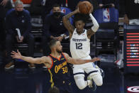 Memphis Grizzlies' Ja Morant, right, passes against Golden State Warriors' Stephen Curry during the second half of an NBA basketball Western Conference play-in game in San Francisco, Friday, May 21, 2021. (AP Photo/Jed Jacobsohn)