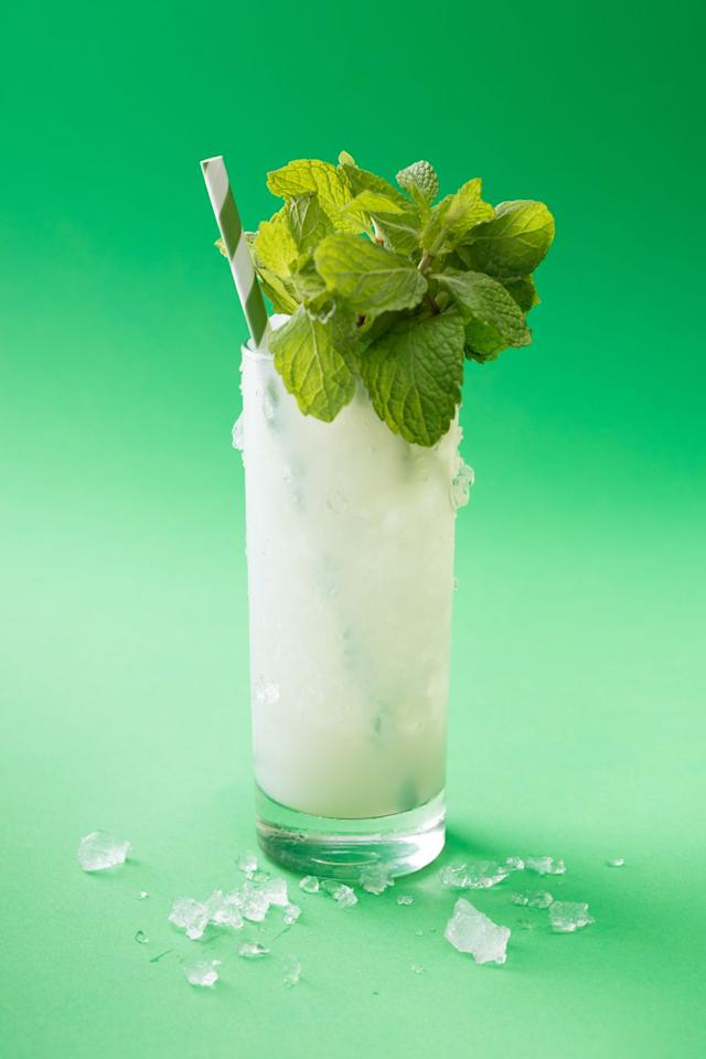 """<p>Mint leaves</p><p>1 1/5 oz Absinthe</p><p>1/2 oz Simple syrup </p><p>4 oz Seltzer</p><p>Ice<br><br>Put 8-10 mint leaves into a tall glass. Gently and briefly, so as not to break or bruise, use the back side of a bar spoon to press the leaves against the sides of the glass, until you can smell the mint. To this, add absinthe and simple syrup. Stir to combine, and add seltzer. Top fully with ice, and garnish with as much mint as your glass will hold, giving the bunches a quick slap between the hands beforehand will release oils on the surface and make the mint more aromatic. Add a straw and enjoy. <br><br><em>Via <a rel=""""nofollow"""" href=""""https://www.sharpshootersf.com/"""">Ian McCarthy of Sharpshooter SF</a></em><br></p>"""