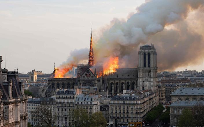 Bells will toll at English churches tonight to mark the moment the fire started at Notre-Dame yesterday - AFP
